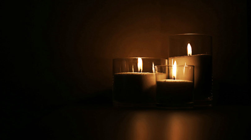 three candles signifying darkness and grief