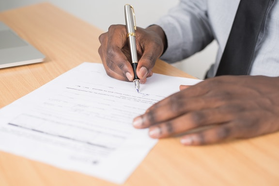 black person writing a will