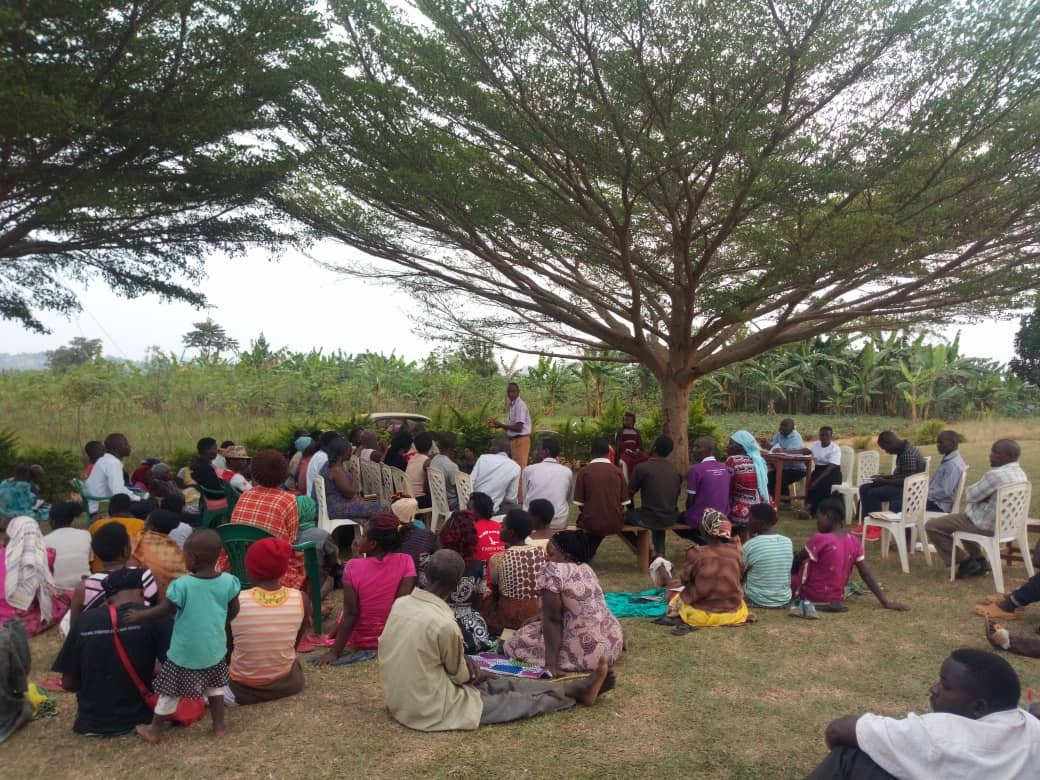 Justice Centres Uganda outreach - JCU staff giving legal advice to communities
