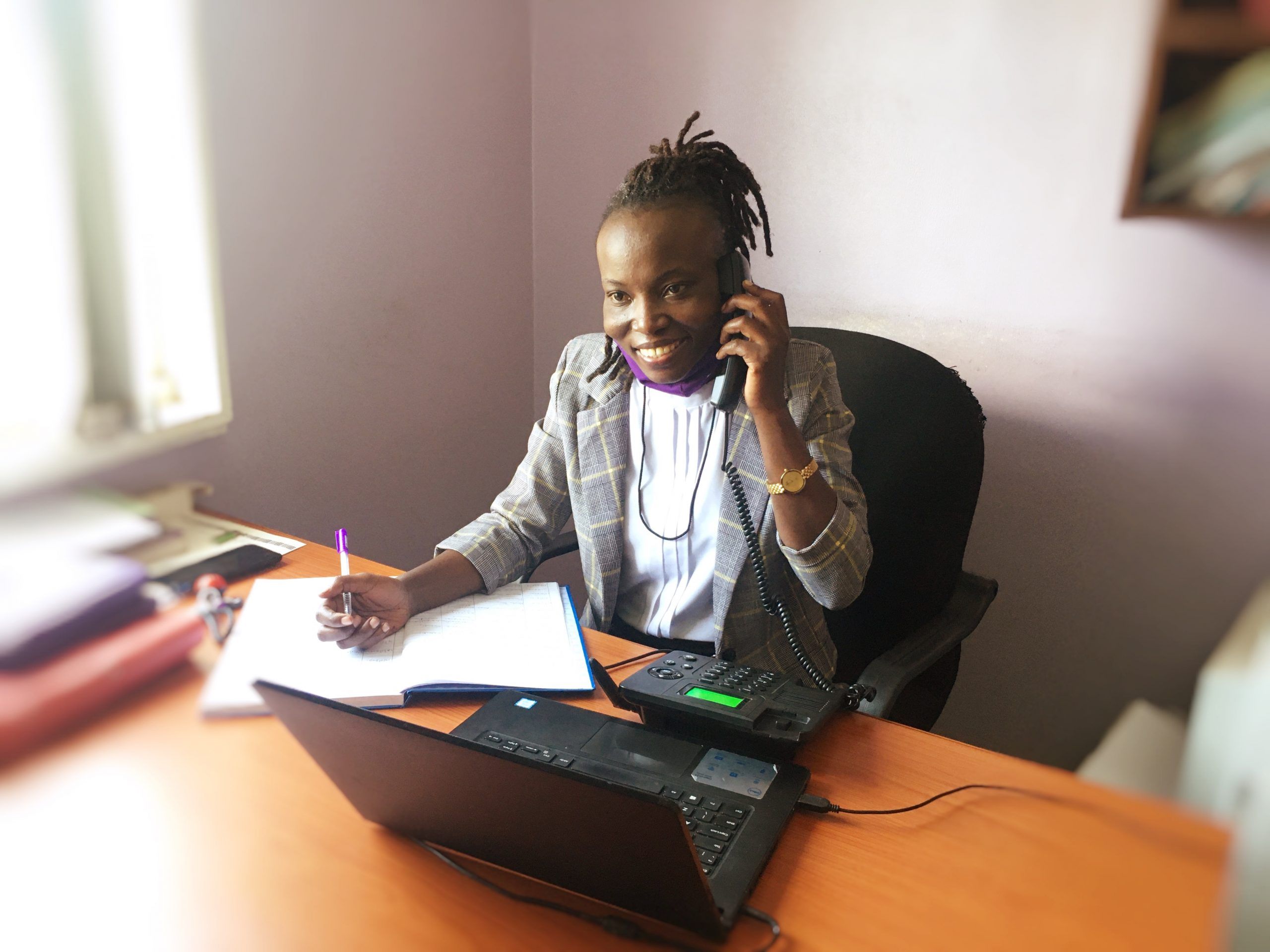 JCU employee answering toll-free telephone and giving legal advice
